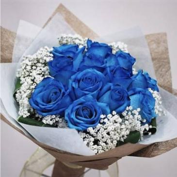 1 Dozen Blue Roses with baby breath in vase **PRE-ORDER 3- 5 DAYS ADVANCE**