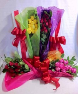 One Dozen Roses bundled in paper Roses