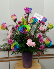 12 RAINBOW ROSES W/MINI CARNS CENTERPEICE