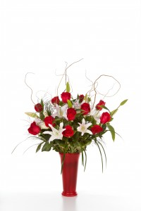 12 Rose Luxurious Vase Rose and Lilly arrangement  in Clearwater, FL | FLOWERAMA