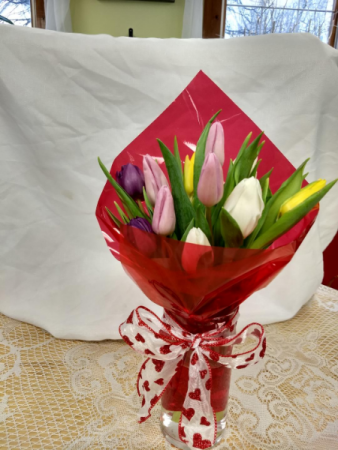 12 tulips wrapped in vase