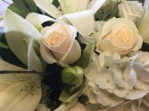 125 White handtied bouquet wrapped in cellophane - not arranged in a vase