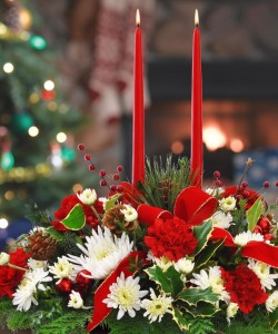 Classic Christmas Centerpiece Fresh Fragrant evergreens, candlelight & holiday colored flowers in Canon City, CO | TOUCH OF LOVE FLORIST AND WEDDINGS