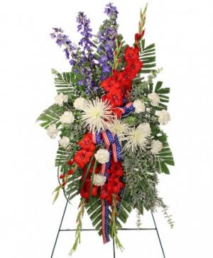 Salute To A Service Member Standing Spray in Richland, WA | ARLENE'S FLOWERS AND GIFTS