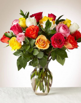 2 dozen mixed colored roses in a vase