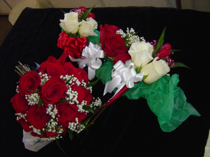 2 dozen Rosa-Prima Roses in a Vase Red, White, or a mix of both are available this year!  Specify in the
