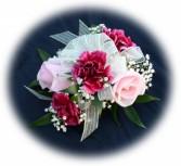 2 pink Roses 3 burg. carns Wrist Corsage