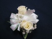 2 Rose Corsage, $20.00 Available in white, red, yellow, pink, orange