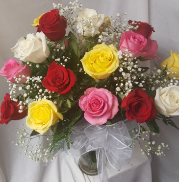 21 mixed colored roses arranged in a vase with baby breath! POPULAR FOR 21ST BIRTHDAY!!