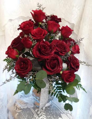 2 dozen roses in a vase
