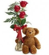 3 Red Roses in a vase with filler and bow!!  Price Includes a medium size bear too!