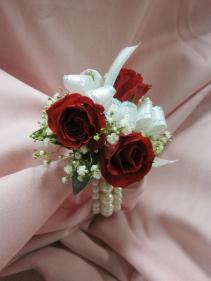 3 Rose Corsage, 3 Pearl Strand Bracelet, $35.00