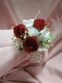 3 Rose Corsage on Pearl Wide Band, $35.00
