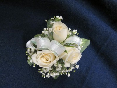 3 Rose Corsage Round Style  $25.00 Pink, Yellow, Hot Pink, Orange and Red also available