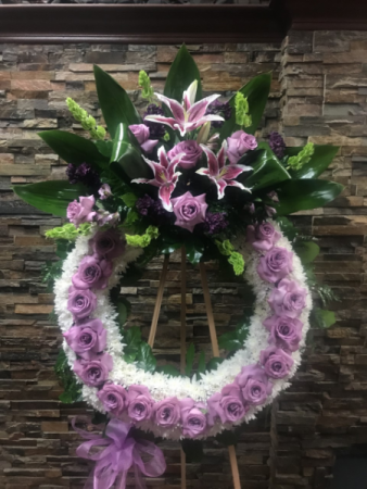 """LAVENDER ROSE CIRCLE OF LIFE 45"""" WREATH W/ CENTER CLUSTER ON 6' STAND"""