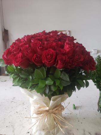 4 dozen roses in a vase
