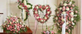 4 PC FAMILY FUNERAL PACKAGE/PINKS/WHITES CASKET,CROSS,OPEN HEART, AND STANDING SPRAY