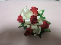 5 Rose Corsage, $35.00 Available in white, red, pink, orange, yellow