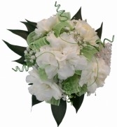 5 white mini carnations, green bow, and wire.  Wrist Corsage
