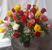 50 years old? 50th anniversary? 50 mixed roses  Arranged in a vase with baby's breath!