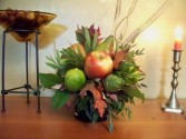 Truly Grateful  Fruit and Flowers Accent this lovely centerpiece.