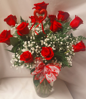 DOZEN RED ROSES WITH HEART PIC ARRANGED IN A VASE WITH BABY'S BREATH AND BOW!