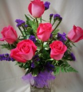 6 Pink Roses and purple status arranged in a  cube vase(if PURPLE status is not available we will use baby's breath or wax flower)