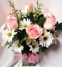 6 Pink Roses with white daisies and filler  arranged in a vase!