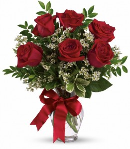 6 RED ROSES ARRANGED IN A VASE WITH WHITE or  PURPLE WAX FLOWERS or baby's breath AND BOW!