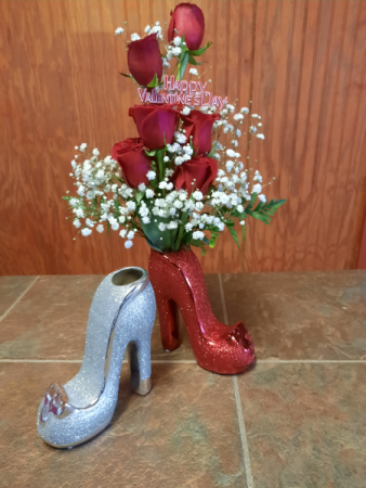 6 roses arranged in a high-heel shoe