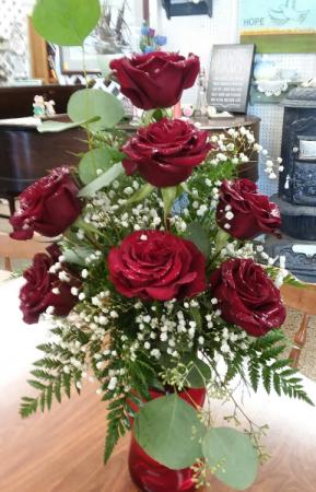7 roses in a vase