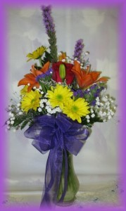 A Bright Hello Buds 'n Bows Vase Arrangement