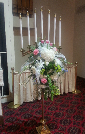 A Candleabra Spray Rental With Flowers