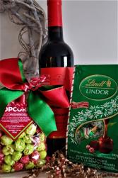 A CHRISTMAS GIFT Wine, chocolates and caramel popcorn