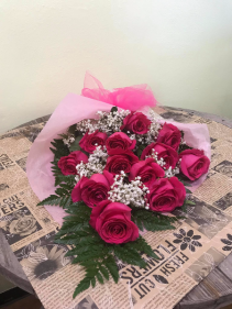 A Dozen Pink Roses Wrapped in Tissue