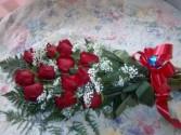 a dozen red rose presentation bokay