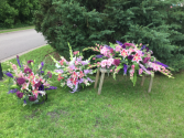 A garden of memories casket spray, 2 urn bouquets