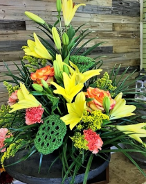 A Little Florida Sunshine Container Arrangement