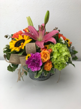 A Tin of Spring  Container Arrangement