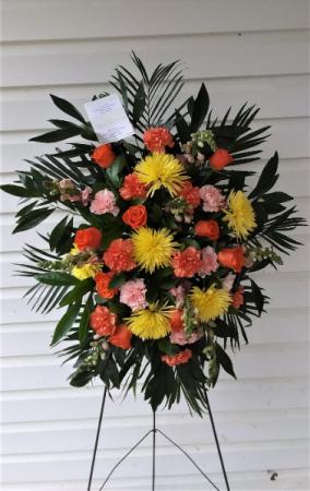 A Vibrant Life Funeral spray