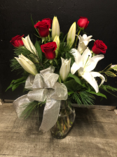 A Walk In The Pines Vased Arrangement of Lilies, Roses & Christmas Greens