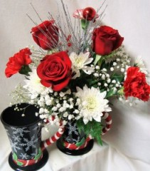 Tall Snowflake mug with Red roses, white cushion poms, baby's breath, peppermint carnations and some bling!!