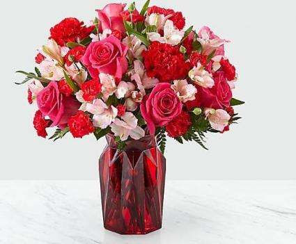 Adore You ™ Bouquet Fall in love at first sight with our Adore You™ Bouquet. Beautifully designed with hot pink roses, red carnations and pink alstroemeria.
