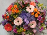 BRIGHT MEMORIES  Half Casket Spray of Lavenders, oranges, pinks and lime greens. Spray roses, gerbera daisies, carnations, button poms and berries