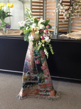 Afghan with Fresh Arrangement on stand