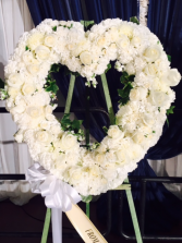 All white open heart wreath with roses & carnation