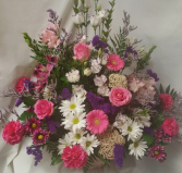 """Always Remembered"" Pinks, purples, whites funeral arrangment."