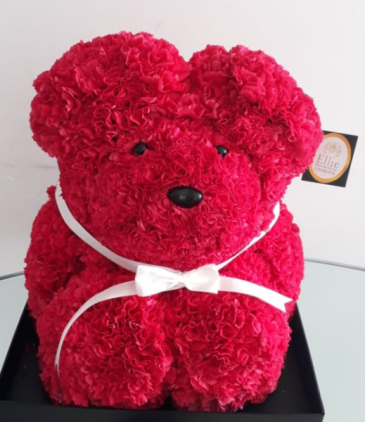 Teddy bear with natural flowers