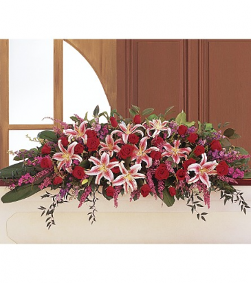 Amethyst and Ruby Cskt Spry One-Sided Floral Arrangement