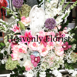 MOM YOURE AN ANGEL  Angel statue with flowers  in Ozone Park, NY | Heavenly Florist